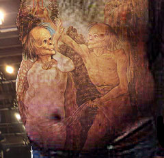 Karl Rove prison tattoos, detail (chest, belly)